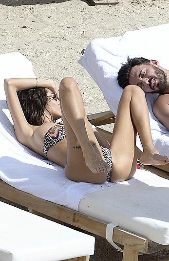 Nabilla Benattia topless on a beach in St. Barts