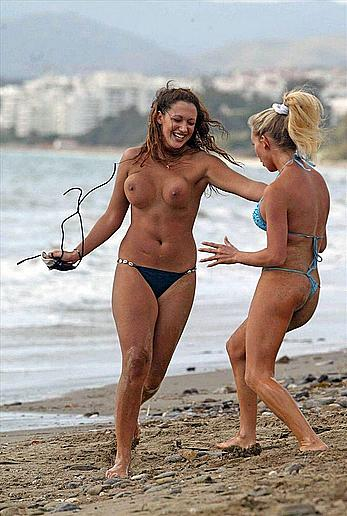 Natalie Denning topless on a beach