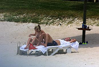 Natalie Appleton sunbathing topless on a beach