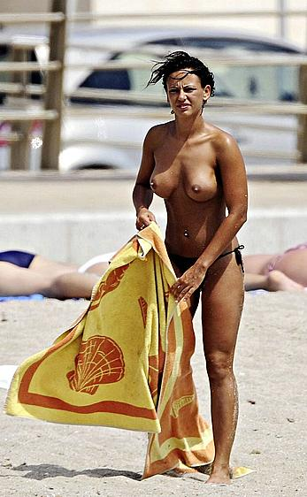 Nereida Gallardo sunbathing topless on a beach