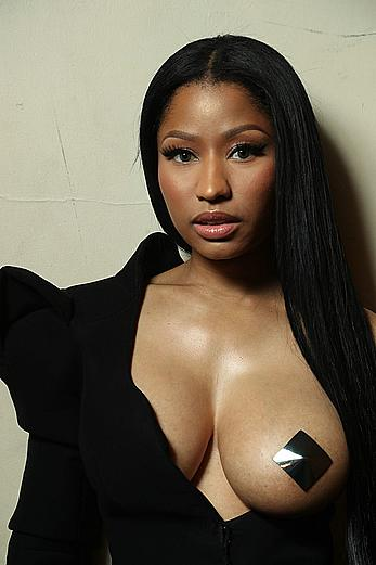 Nicki Minaj nude boob with pastie at Haider Ackermann fashion show