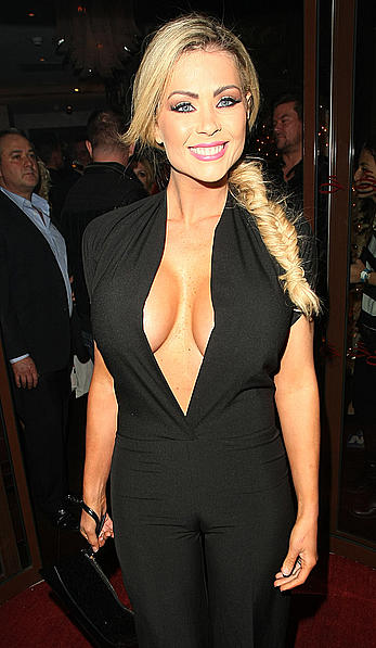 Busty Nicola McLean shows sexy cleavage at Now Magazine Christmas Party in London
