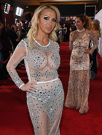 Busty Nikki Benz braless in see through dress