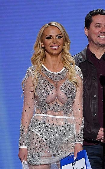 Busty Nikki Benz braless in see through dress