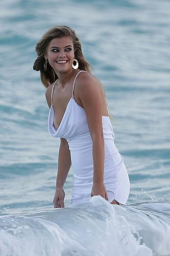 Nina Agdal titslip during photoshoot for Bebe on the beach in Miami