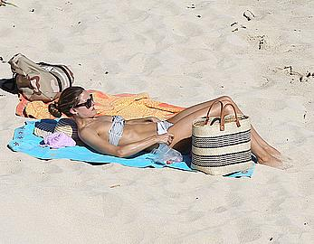 Olivia Palermo sunbathing without bra on the beach in St. Barths