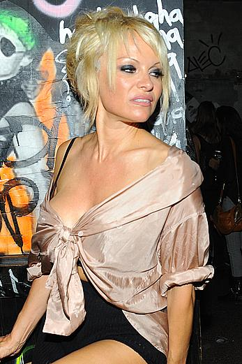 Pamela Anderson sexy cleavage, almost areola slip