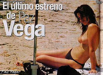 Paz Vega sunbathing topless on a beach