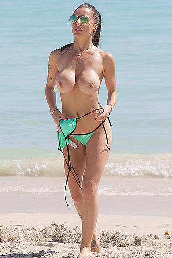 Busty Priscilla Salerno topless on a beach