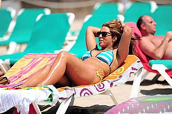 UK Big Brother 11 babe Rachael White in bikini and topless on a beach paparazzi photos