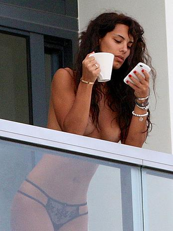 Raffaella Modugno topless on a balcony