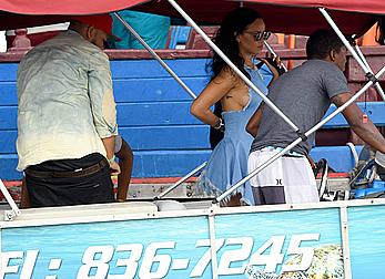 Rihanna pokies under blue short dress in Barbados
