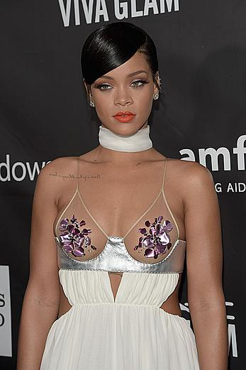 Rihanna covers up her nipples at amfAR LA Inspiration Gala in Hollywood