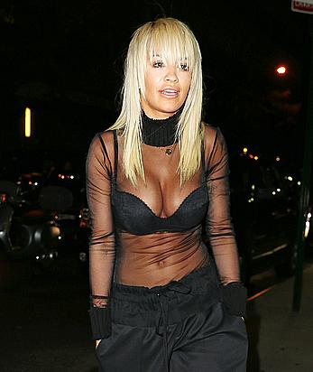 Rita Ora deep cleavage when leaving a radio station