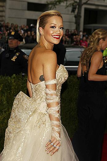 Rita Ora legs and cleavage at 2014 Met Gala in NY