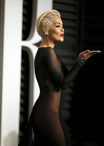 Rita Ora no bra and pants under dress at 2015 Vanity Fair Oscar Party in Hollywood