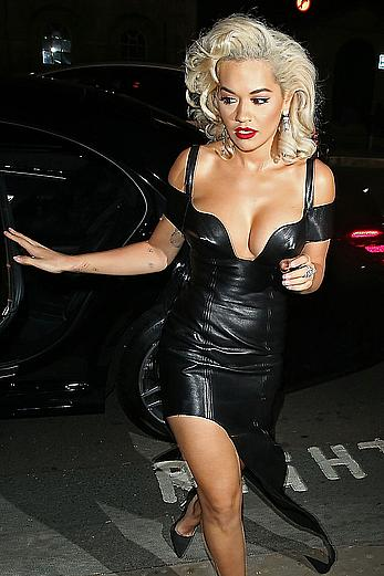 Rita Ora legs and cleavage at the UNICEF UK Halloween Ball in London