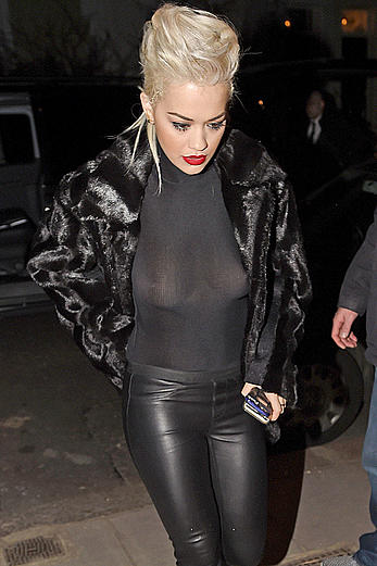 Rita Ora nude boobs under see through top after concert
