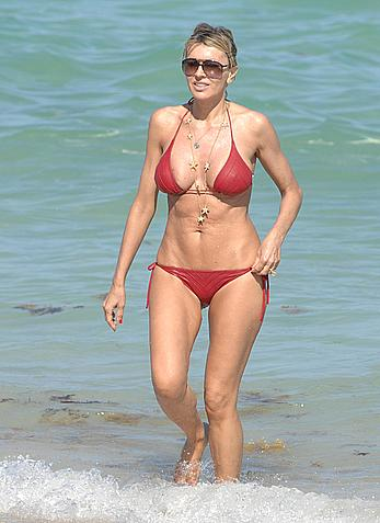 Rita Rusic in red bikini at a beach
