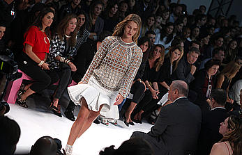 Rosie Huntington-Whiteley nude tits under fishnet transparent top at balmain fashion show