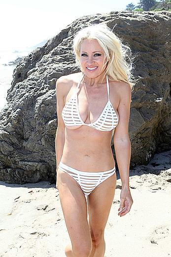 Sara Barrett areola slip in a white tiny bikini on the beach in Malibu