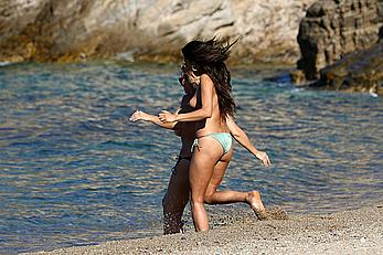 Shay Mitchell topless with friends at a beach in Mykonos