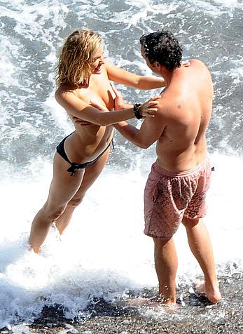 Sienna Miller caught topless on a beach