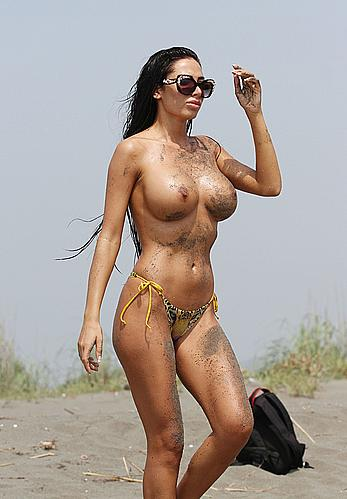 Busty Soraja Vucelic goes topless to show her boobs at a beach
