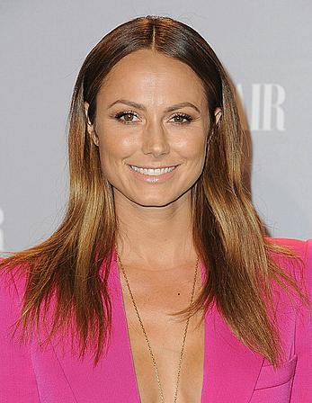 Stacy Keibler without bra under pink jacket at Vanity Fair & FIAT Young Hollywood event