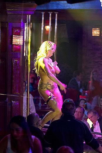 Stormy Daniels fully nude in a strip club