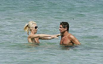 Tamara Beckwith topless on a beach with friend