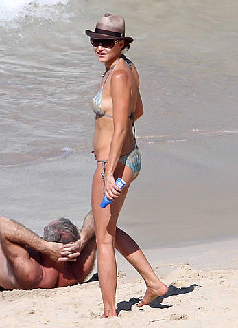Tamara Mellon sexy in bikini on a beach