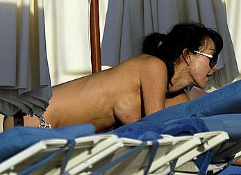 Tamara Mellon caught topless on the beach