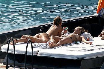 Tania Cagnotto sunbathing topless on a boat