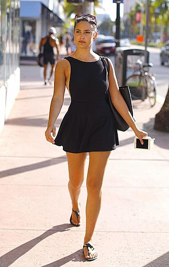 Tao Wickrath in shorts dress shows sideboob