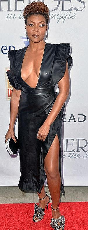 Taraji P. Henson cleavage and pokies in black leather dress