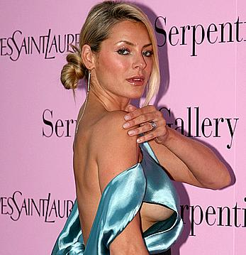 Tess Daly oops, shows side of boob and areola slip