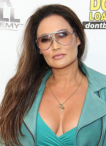 Tia Carrere sexy cleavage at Gutshot Straight premiere