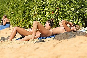 Toni Garrn sunbathing topless on a beach in Hawaii