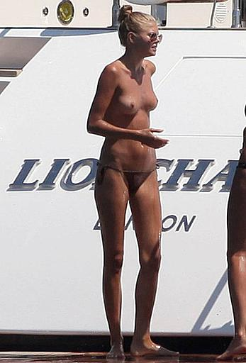 Toni Garrn in bikini and topless on a yacht in Ibiza
