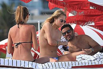 Toni Garrn topless on a beach with friends