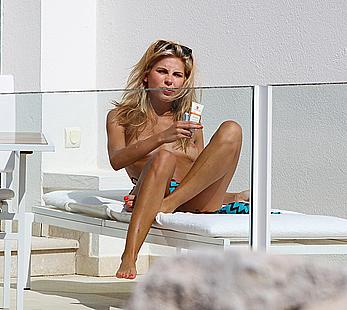Australian model Jessica Hart sunbathing topless at Eden Roc hotel in Antibes