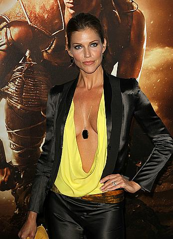 Tricia Helfer in low cut blouse at Riddick premiere