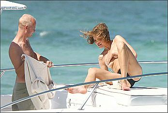 Natalia Vodianova sunbathing topless on a yacht in St Barth