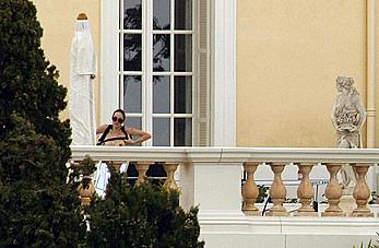 Angelina Jolie caught topless on the hotel balcony