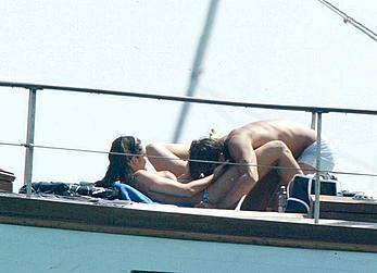 Manuela Arcuri sunbathing topless on a yacht