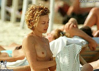 Kylie Minogue sunbathing topless on a beach