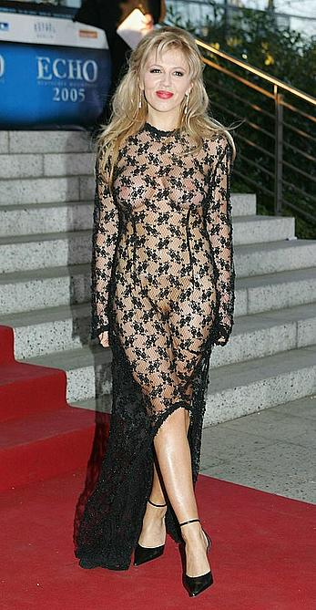 Davorka Tovilo topless under transparent fishnet dress