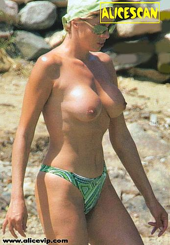 Ela Weber topless on a beach with honey