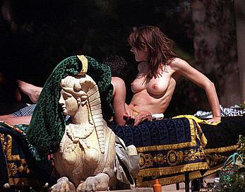 Elizabeth Hurley sunbathing topless
